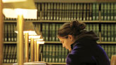 Photo of a student in a library